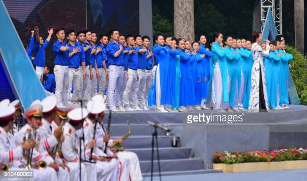Performers sing a revolutionary song during a ceremony marking the 50th anniversary of the Tet Offensive in Ho Chi Minh City on January 31 2018...