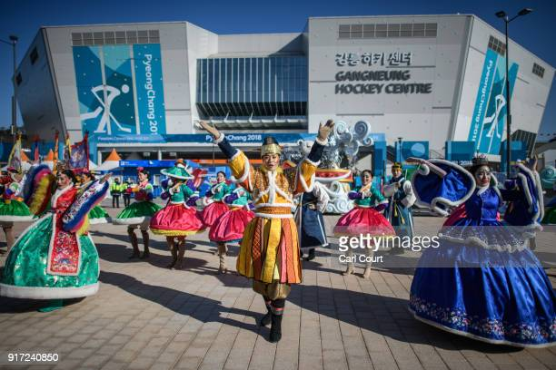 Performers sing and dance as they parade through Gangneung Coastal Cluster on day three of the PyeongChang Winter Olympics on February 12 2018 in...