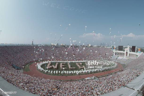 Performers spell out Welcome on the stadium infield as balloons are released above them during the opening ceremony for the XXIII Olympic Games on 28...