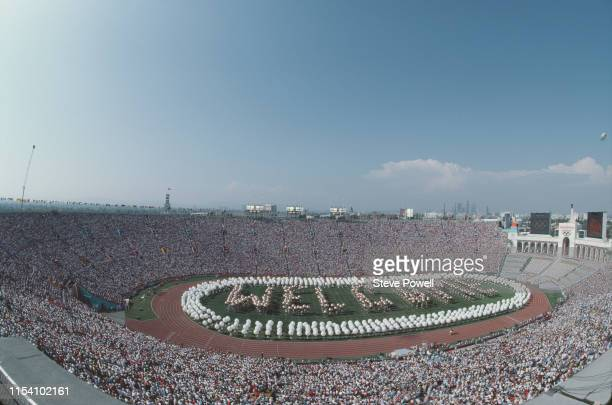 Performers spell out Welcome on the stadium infield during the opening ceremony for the XXIII Olympic Games on 28 July 1984 at the Los Angeles...