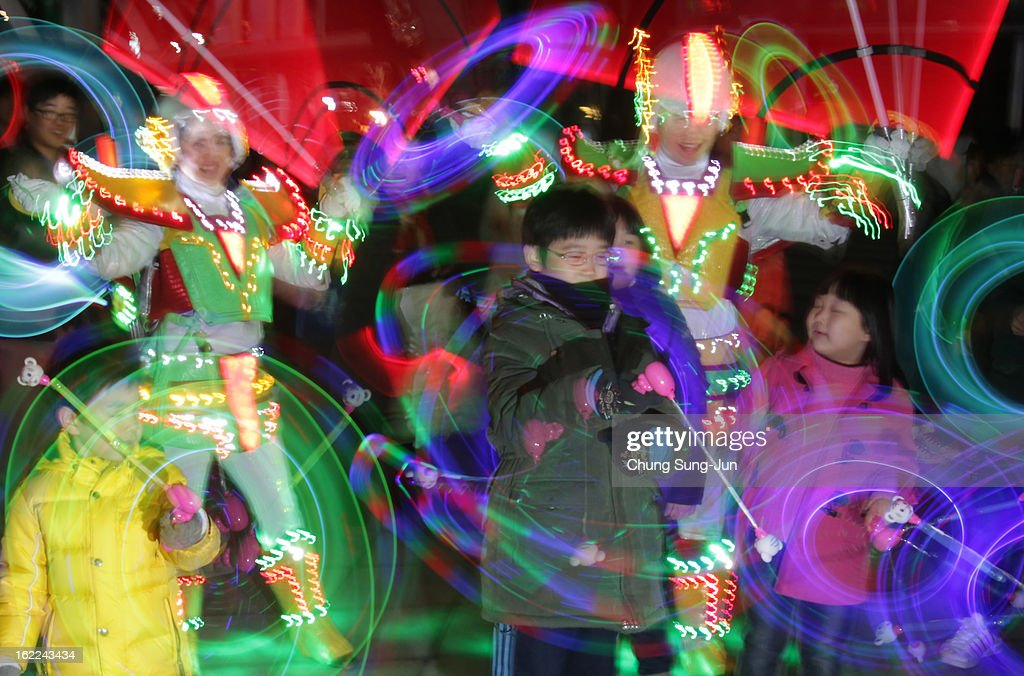 Performers spin illuminated cans during 'Cyber Jwibulnoli' at Everland on February 21, 2013 in Seoul, South Korea. Jwibulnoli is originally played on the first full moon of the lunar year, that is February 25 this year.
