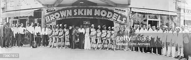 Performers stand outside the marquee for Irving C Miller's Harlem Road Show Brown Skin Models in the late 1930's