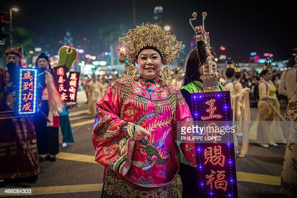 Performers take part in a Chinese New Year parade in Hong Kong on January 31 2014 Chinese communities across Asia have come together to usher in the...
