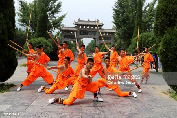 Performers take part in a martial arts performance at Shaolin Temple on Mount Songshan in Dengfeng County on July 7, 2018 in Zhengzhou, Henan...