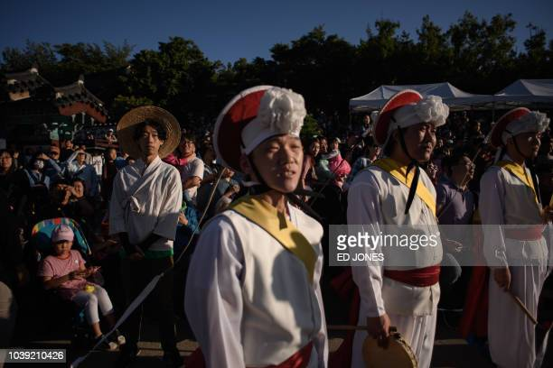 Performers take part in a traditional dance at the Namsangol hanok village in Seoul on September 24 2018 South Koreans are observing the annual...