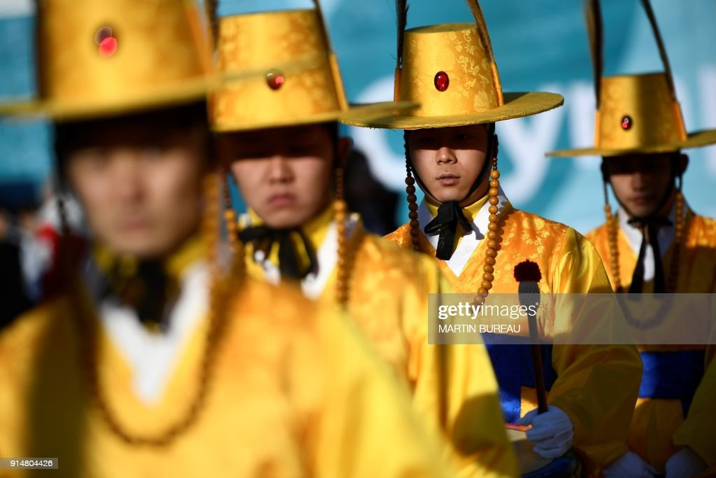 TOPSHOT - Performers take part in a welcome ceremony a few days before the Pyeongchang 2018 Winter Olympic Games, at the Olympic Village in Pyeongchang on February 6, 2018. / AFP PHOTO / Martin BUREAU