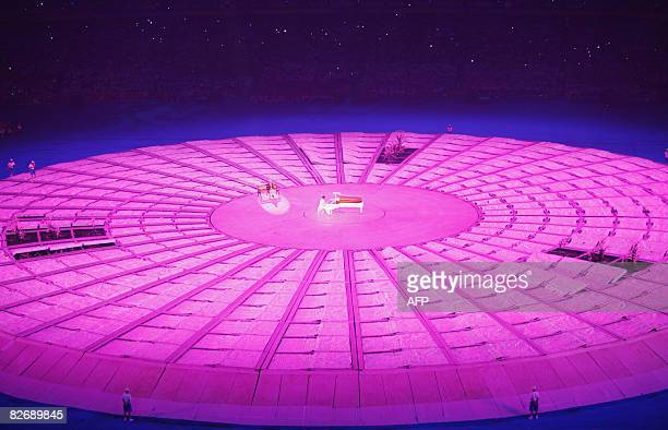 Performers take part in the 2008 Beijing Paralympic Games opening ceremony at the National Stadium better known as the Bird's Nest in the Chinese...