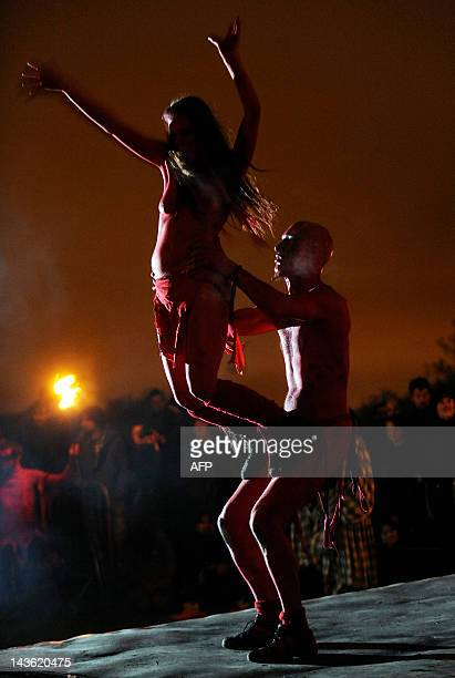 Performers take part in the Beltane Fire Festival on Calton Hill in Edinburgh on April 30 2012 The annual event is inspired by the preChristian...
