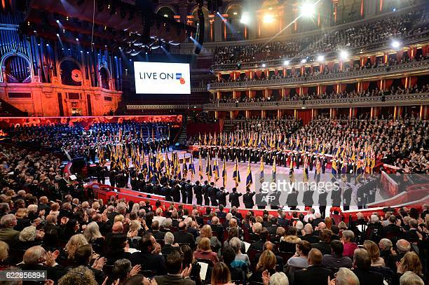Performers take part in the Festival at the Royal Albert Hall during the annual Royal Festival of Remembrance in central London on November 12 2016...
