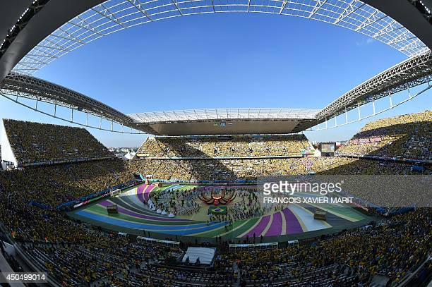 Performers take part in the opening ceremony of the 2014 FIFA World Cup at the Corinthians Arena in Sao Paulo on June 12 prior to the opening Group A...