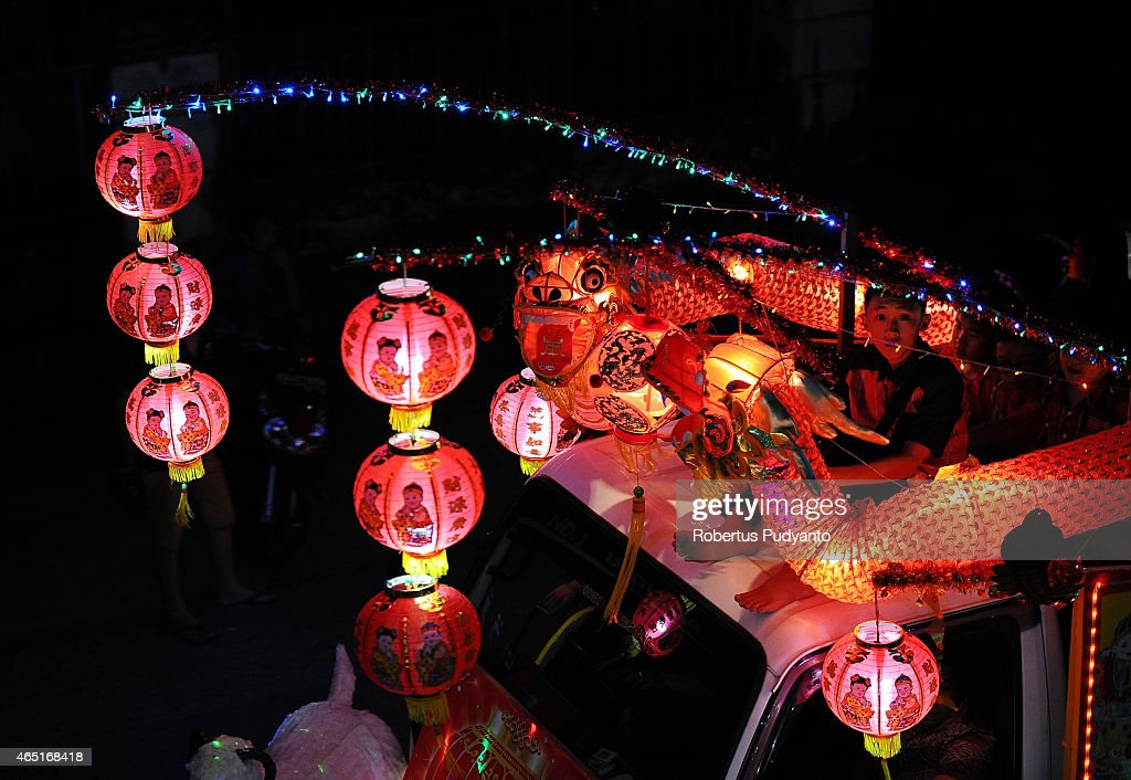 SINGKAWANG, KALIMANTAN, INDONESIA - MARCH 03: Performers take part in the Singkawang lantern festival on March 3, 2015 in Singkawang, Kalimantan, Indonesia. Thousands of performers attended the annual parade in Singkawang, where hundreds of lanterns, all with a unique design and story are on display. Cap Go Meh Festival also know as the Lantern Festival is celebrated on the 15th day of the Chinese Lunar Year and marks the end of Chinese New Year celebrations.
