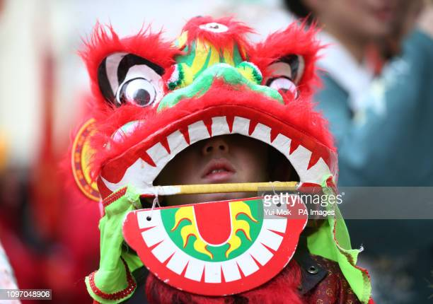 Performers taking part in a parade involving costumes lion dances and floats during Chinese New Year celebrations in Chinatown London which marks the...