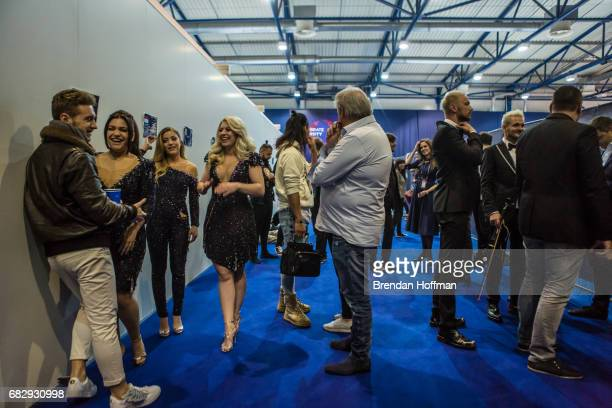 Performers wait back stage before the final rehearsal for the Eurovision Grand Final on May 13 2017 in Kiev Ukraine Ukraine is the 62nd host of the...