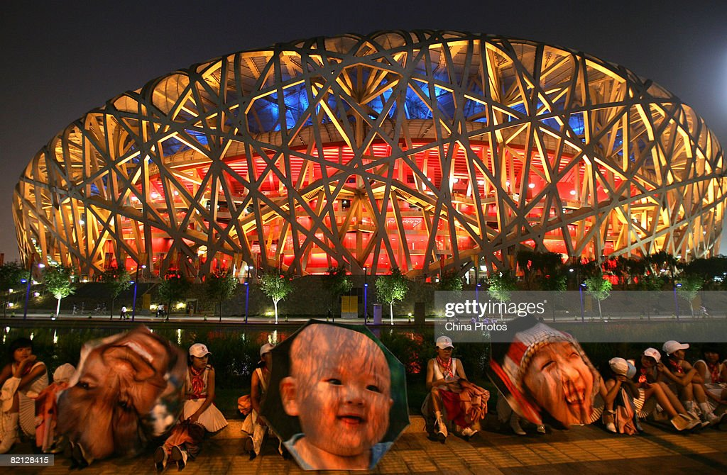 Performers wait their turn outside the National Stadium during the first dress rehearsal for the opening ceremony of the Beijing Olympic Games July 30, 2008 in Beijing, China. Beijing is making its final preparations for the upcoming Olympics.