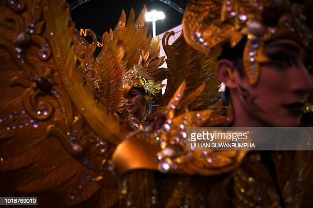 TOPSHOT Performers wait to get on stage during the opening ceremony of the 2018 Asian Games at the Gelora Bung Karno main stadium in Jakarta on...