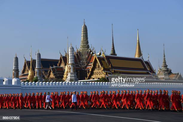 Performers walk from the Grand Palace as they prepare to take part in the funeral procession for the late Thai King Bhumibol Adulyadej in Bangkok...