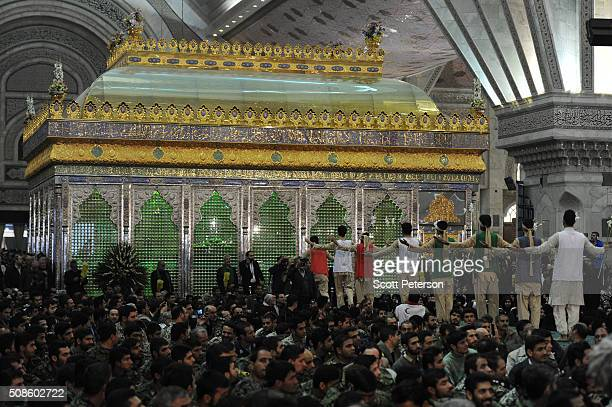 Performers walk toward the shine holding the remains of the ayatollah as Iranian officials and security forces mark the 37th anniversary of the day...