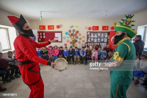 Performers wearing Hacivat and Karagoz costumes perform for the school kids in Van Turkey on February 7 2019 Theater team of Van Ipekyolu...