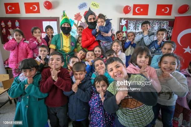 Performers wearing Hacivat and Karagoz costumes pose with school kids in Van Turkey on February 7 2019 Theater team of Van Ipekyolu Municipality...
