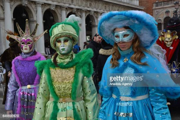 Performers with costumes pose for a photo during the Venice Carnival in Venice Italy on January 26 2017