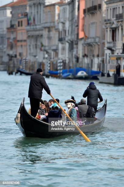 Performers with costumes sail along the Grand Canal during the Venice Carnival in Venice Italy on January 26 2017