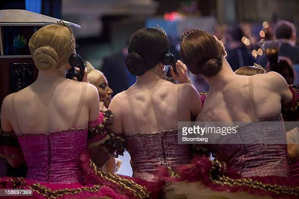 Performers with Les Ballets Trockadero de Monte Carlo pose for a photograph on the floor of the New York Stock Exchange in New York US on Monday Dec...