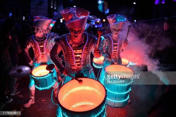 TOPSHOT Performers with 'Spark' an LEDilluminated theatrical drumming ensemble entertain the public during the annual 'Light Night Leeds' festival of...