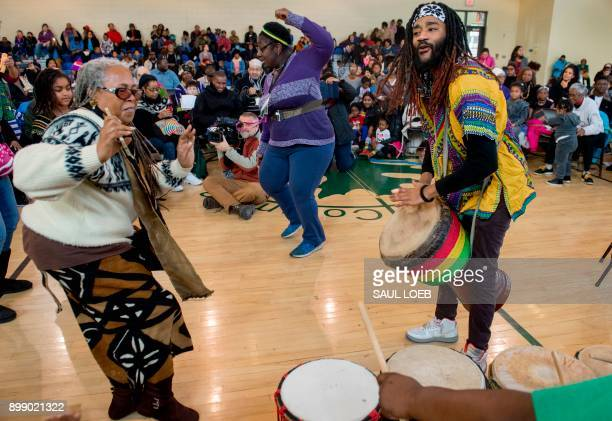 Performers with the African Heritage Dancers and Drummers hold a Kwanzaa celebration hosted by the Smithsonian Anacostia Community Museum at Fort...