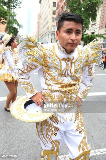 Performers with the Alma Boliviana Folkloric Dance group demonstrate the Bolivian dance of Caporales during the 11th Annual Dance Parade at Greenwich...
