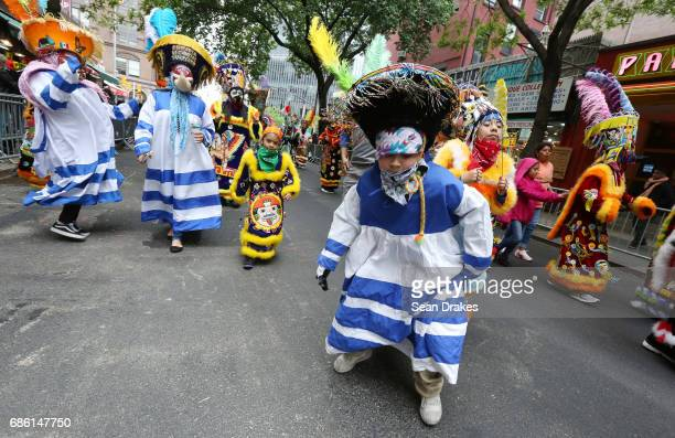 Performers with the Chinelos de Morelos New York folkloric troupe demonstrate a traditional Mexican dance during the 11th Annual Dance Parade at...