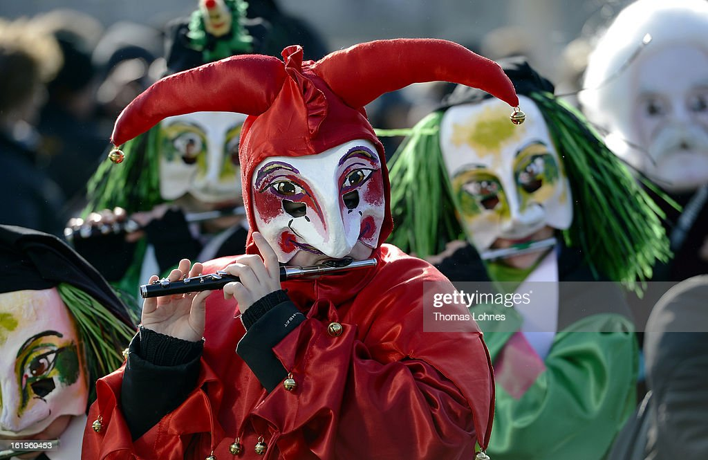 Performers with the mask of the traditional figure 'Uegli' takes part in the Basel Fasnacht Carnival on February 18, 2013 in Basel, Switzerland. More than 12,000 participants will take part in the largest carnival in Switzerland that lasts for 72 hours and will be watched by more than 100,000 spectators as it makes its way through the city center.