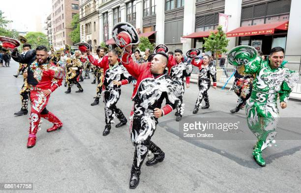 Performers with the San Simon USA folkloric dance troupe demonstrate a traditional Bolivian dance in the 11th Annual Dance Parade at Greenwich...