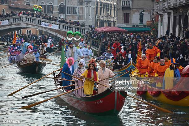 Performers worn masks and interesting costumes sail along the Cannaregio Canal for the Carnival Regatta during the Venice Carnival on January 24 2016...