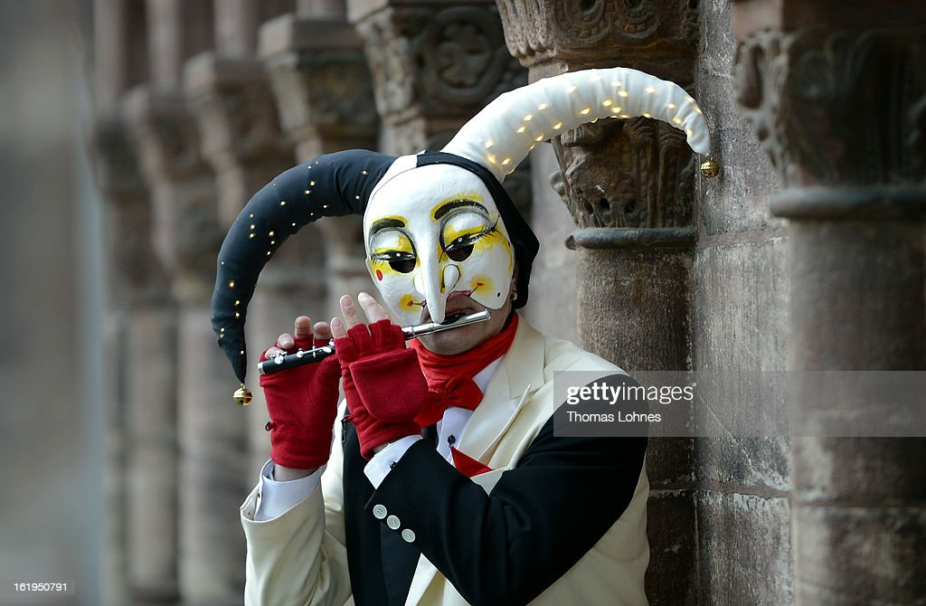 A Performes wearing the 'Ueli' costume playes a piccolo after the traditionell 'Morgestraich' of the Basel Fasnacht Carnival on February 18, 2013 in Basel, Switzerland. The Fasnacht is recognized as the largest popular festival in Switzerland, with between 15,000 to 20,000 masked participants taking part. The prelude is the Morgestraich on the Monday which starts at four in the morning with groups of fifers and drumers moving through the center of town while playing carnival tunes.