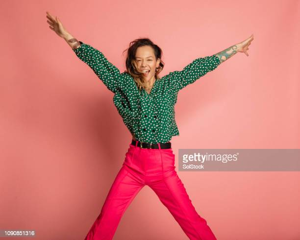 performing a star jump - polka dot stock pictures, royalty-free photos & images