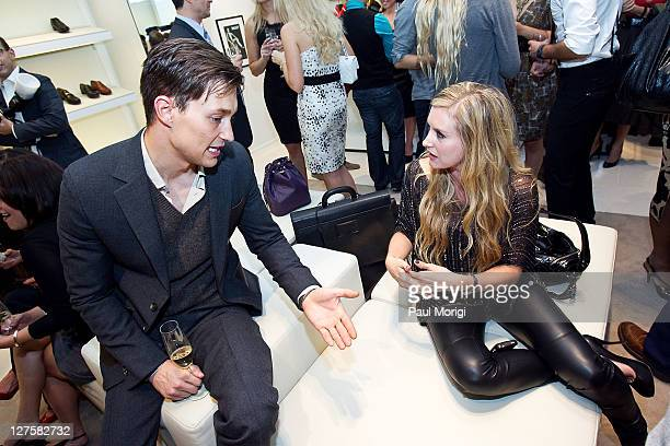 Performing artist Stephanie Quayle talks with a Bally model at the BALLY Grand Opening At Tysons Galleria on September 29 2011 in McLean United States