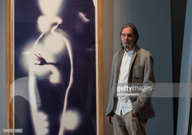 Performing artist Ulay stands next to the artwork 'SelfPortrait' a lifesized work on polaroid material in the exhibiton 'Ulay LifeSized' in Frankfurt...