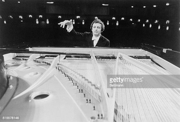 Performing double duty Andre Previn performs as soloist while conducting the Pittsburgh Symphony Orchestra in Mozart's Piano Concert No 20 in D minor...