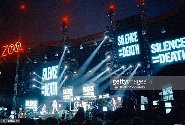 U2 performing on stage at Wembley Stadium in London circa August 1993