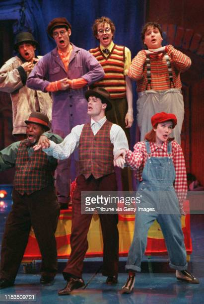 Performing What Do You Want With Money were Guthrie actors Left to rightback row David Norona Thom Christopher Warren Eric Millegan Max Perlman Left...