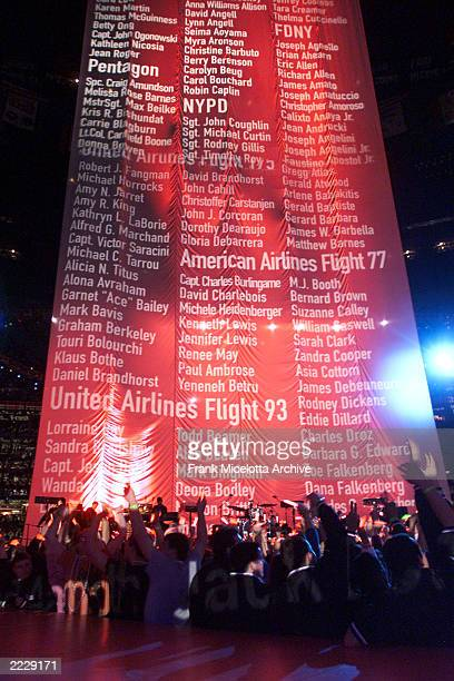 U2 performing while a list of people who died in the September 11th tragedy's scrolls behind them on the Super Bowl XXXVI Halftime Show at the...