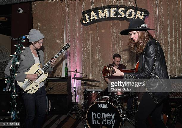 HONEYHONEY performs celebrating the launch of Jameson Music at The Down Out on December 1 2016 in Los Angeles California