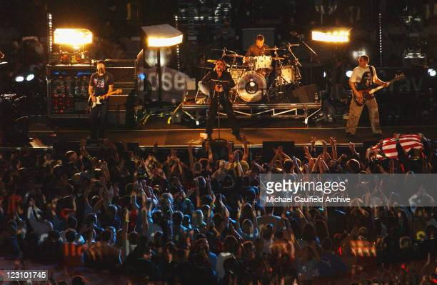 U2 performs during the halftime show at Super Bowl XXXVI in the Superdome New Orleans Louisiana February 3 2002