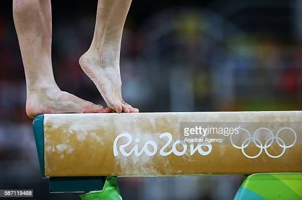 Performs has continued on the balance beam during the artistic gymnastics women's qualification at the 2016 Summer Olympics in Rio de Janeiro on...