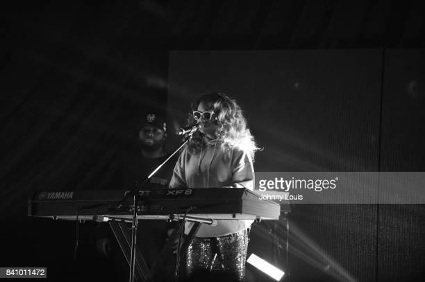 HER performs on stage during Bryson Tiller's Set It Off tour at Watsco Center on August 29 2017 in Coral Gables Florida