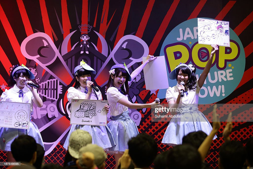 AOP performs on stage during the Anime Festival Asia 2013 at Suntec Convention & Exhibition Center on November 10, 2013 in Singapore.
