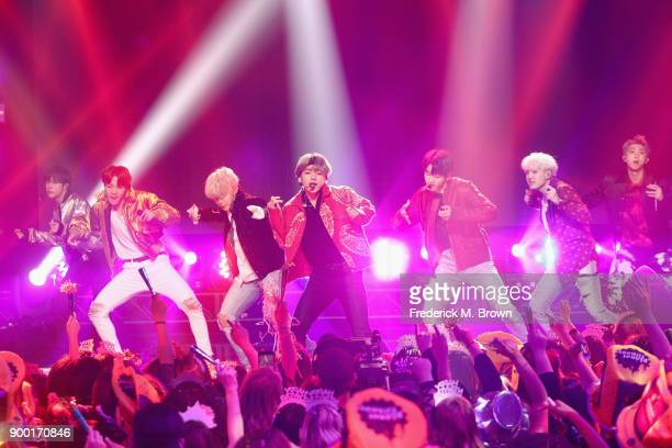 BTS performs onstage during Dick Clark's New Year's Rockin' Eve with Ryan Seacrest 2018 on December 31 2017 in Los Angeles California