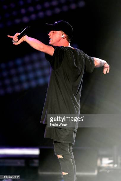 NF performs onstage during the 2018 iHeartRadio Wango Tango by ATT at Banc of California Stadium on June 2 2018 in Los Angeles California