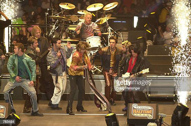 ''NSYNC performs with Aerosmith during the halftime show for Super Bowl XXXV January 28 2001 at the Raymond James Stadium in Tampa FL