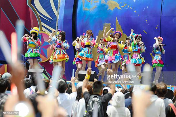 AKB48 performs with characters at the Universal Studios Japan on June 2 2016 in Osaka Japan The idol group will perform everyday to mark the 15th...